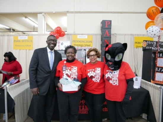 Pennington staff, including Kay as the mascot, with their winning booth and Dr. Shawn Joseph.