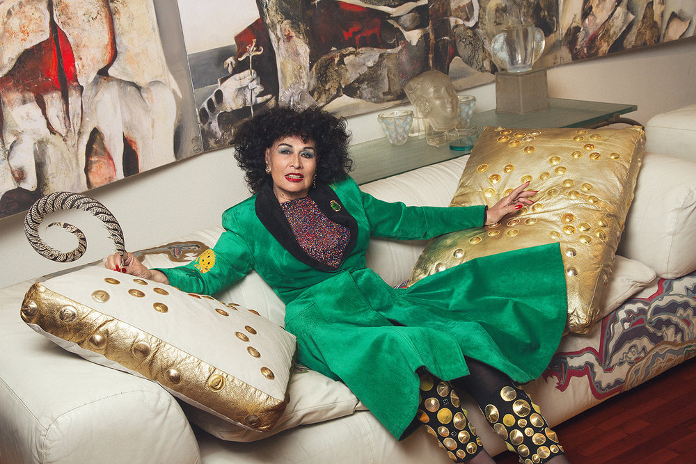Fong-Leng sits on her own designed sofa