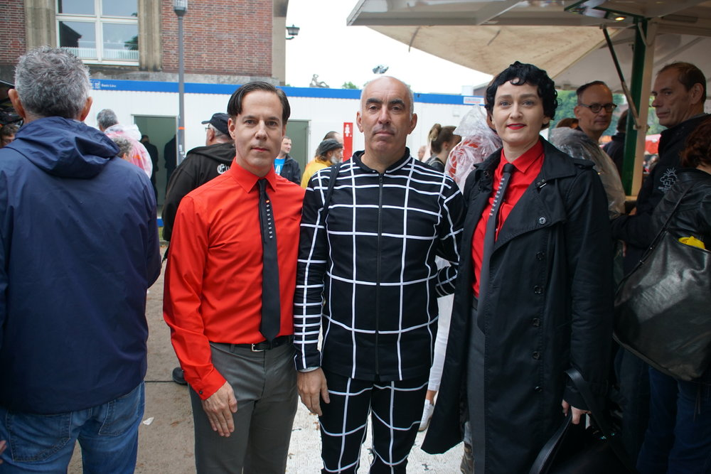 Three Kraftwerk fans attending the legendary open-air concert in summer 2017 in Ehrenhof. Photo Credit: Les Jordan