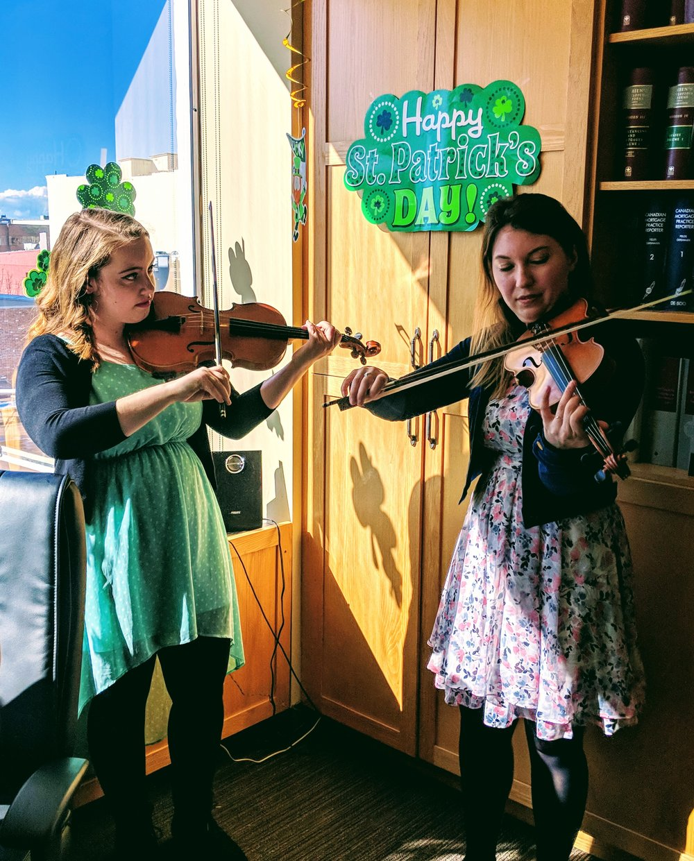 Emily and Aurora from the Victoria Conservatory of Music playing the fiddle