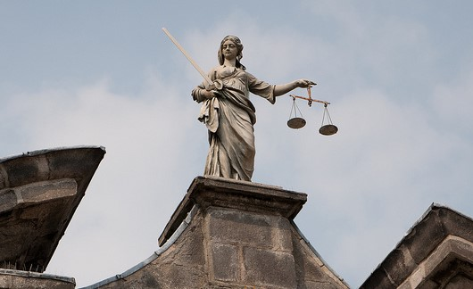 """ Lady Justice at Dublin Castle "" by  Mihai Bojin  /  CC BY 2.0"