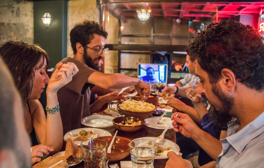 Virtual Dinner guests in Beirut, Lebanon connect to a National Public Radio production team at their table in the U.S.