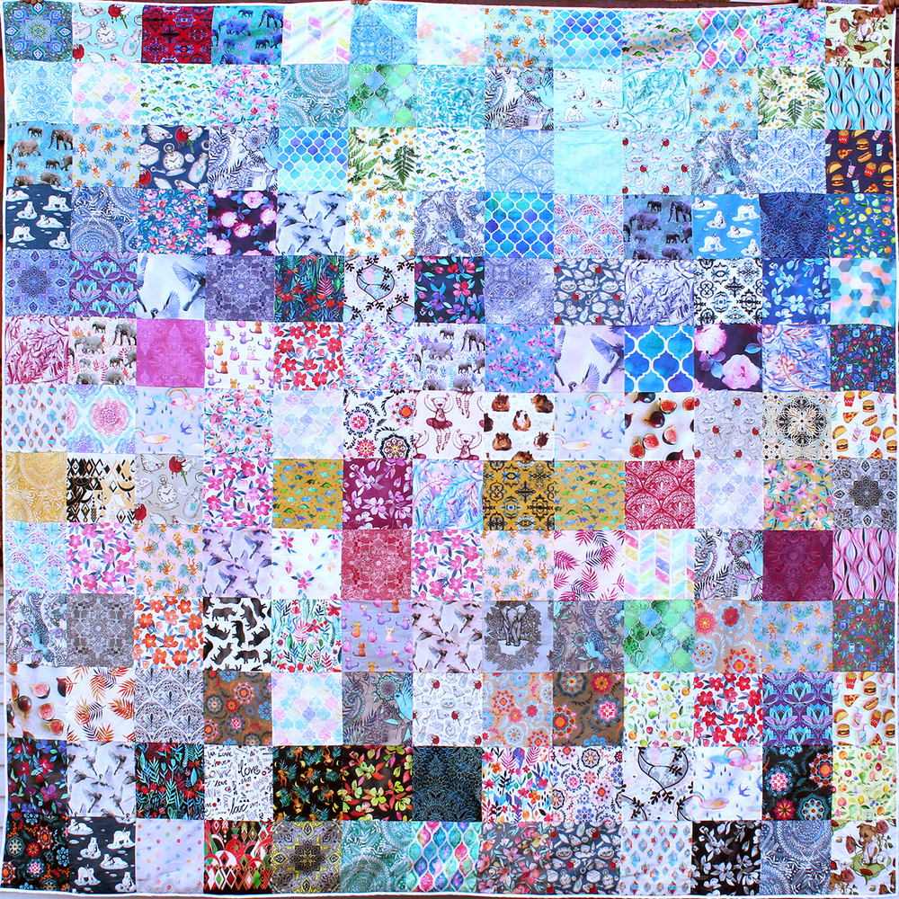 A quilt Micklyn's mom made using swatches from her Spoonflower shop.