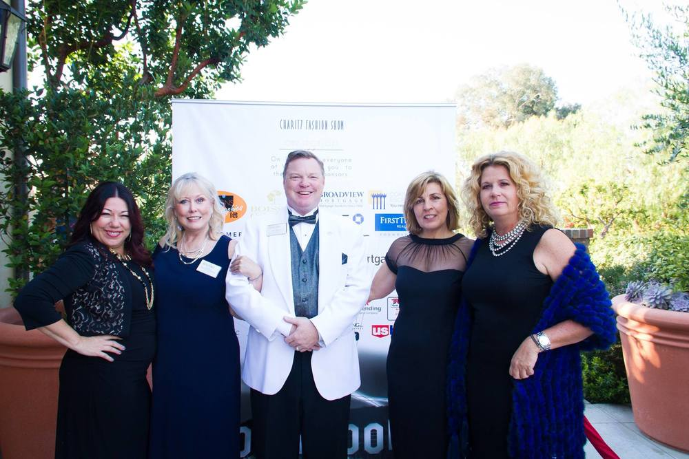 Lighthouse CEO, Jay Mills, stands with distinguished guests at the annual Women's Council of REALTORS fashion show. Lighthouse is a proud supporter of WCR and the work they do in the Orange County community.