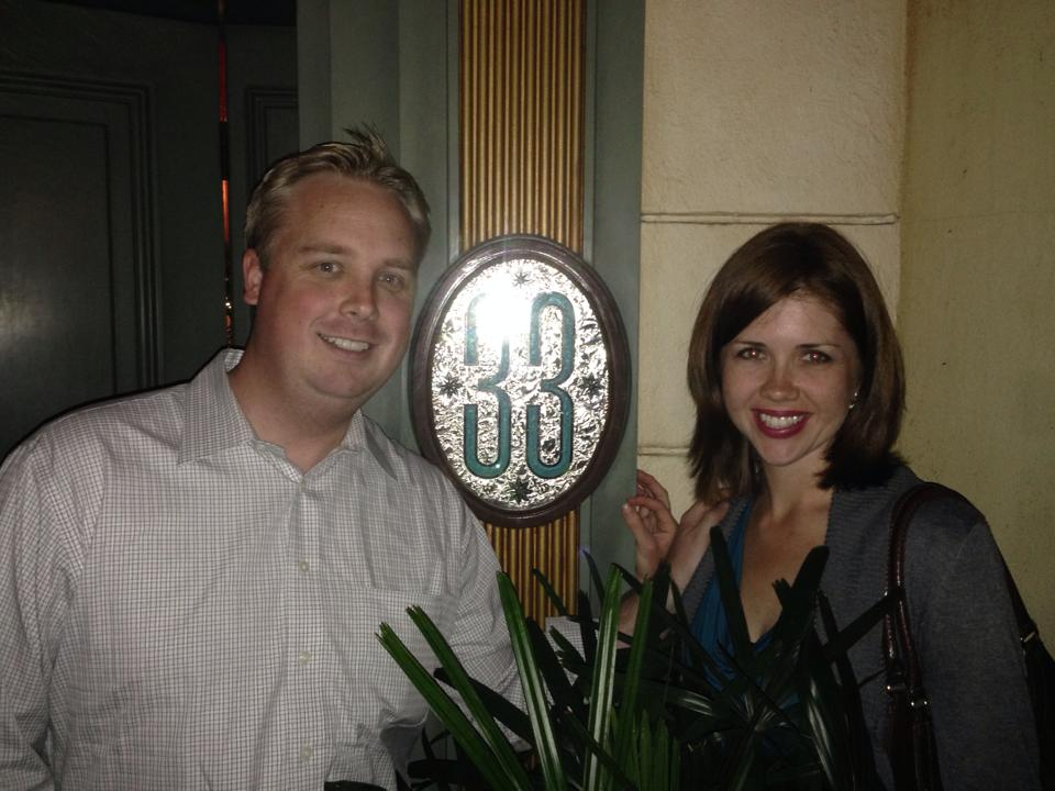 Lighthouse's former COO, Dustin Steeve, and his wife pose for a picture outside of Disney's exclusive Club 33.