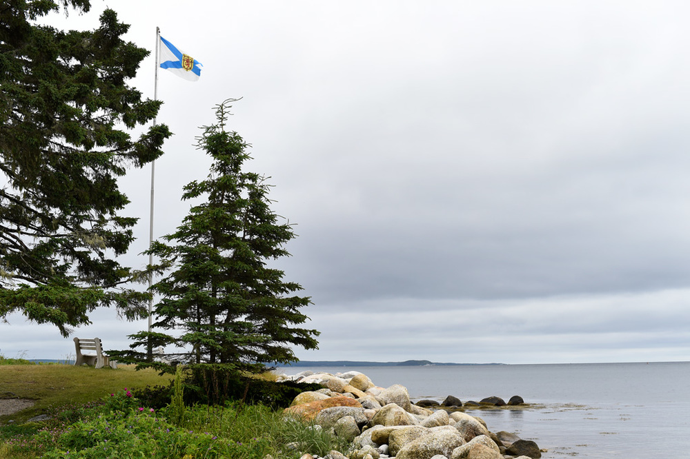 Looking out over St. Margaret's Bay with the Nova Scotia flag flying above.