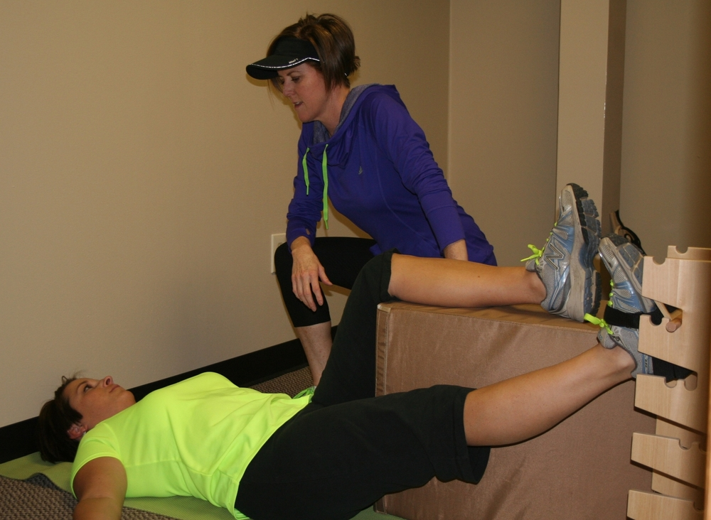 Stasia-Humphreys-Working-With-Client-At-Pain-Free-Clinic-Denver