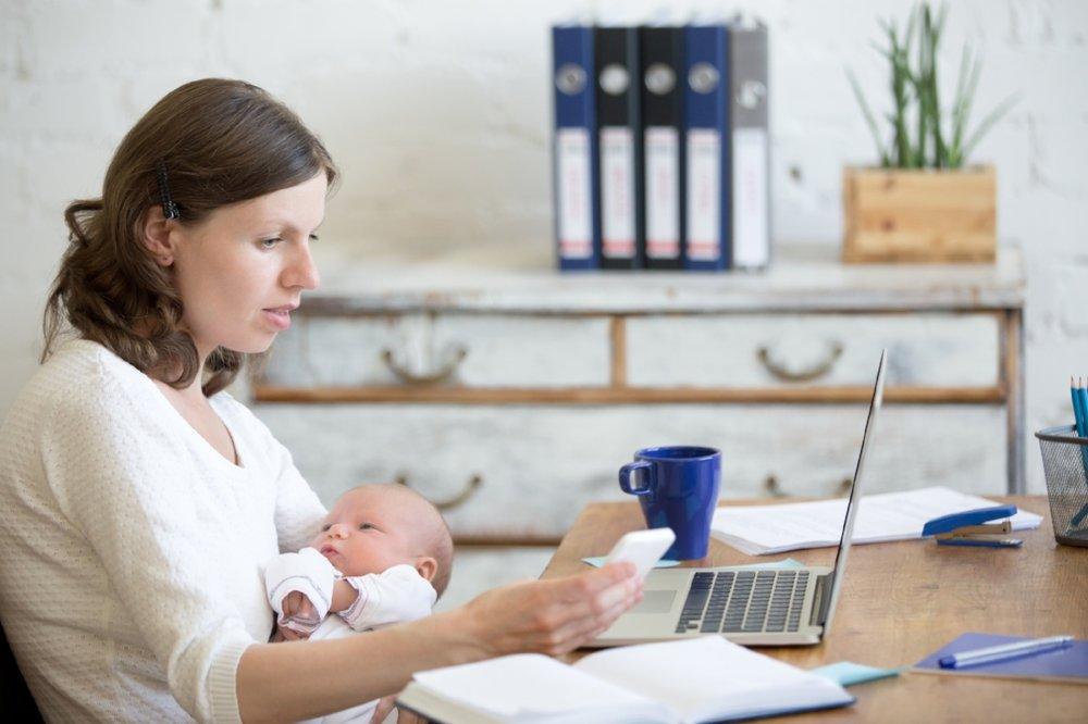 iStock- Mom-Baby-Computer-neck pain.jpg