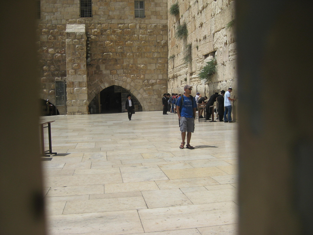 The men-only side of the Western Wall, viewed through the divider between the men's and the women's side.