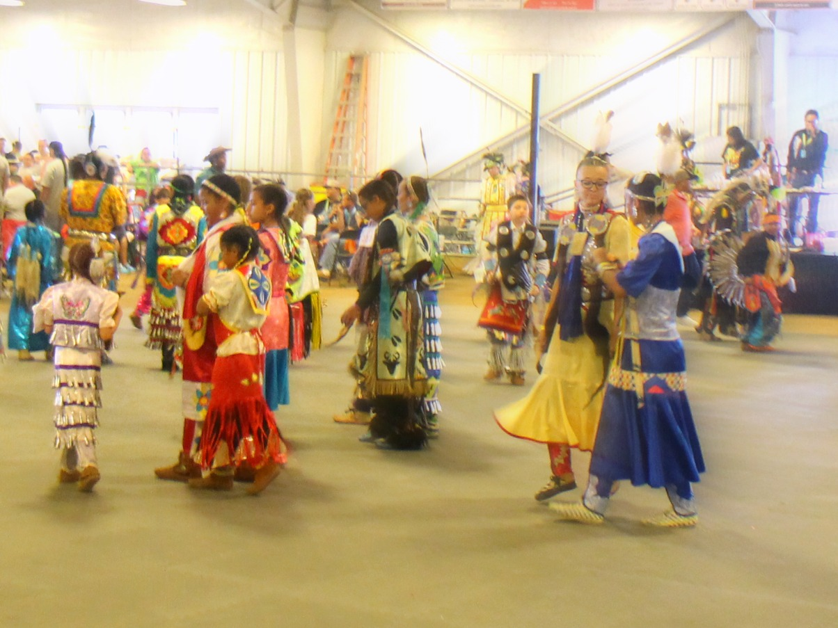 Here you can see the Jingle Dress worn for the Women's Jingle, a dance originating among the tribes of Canada, according to the program.