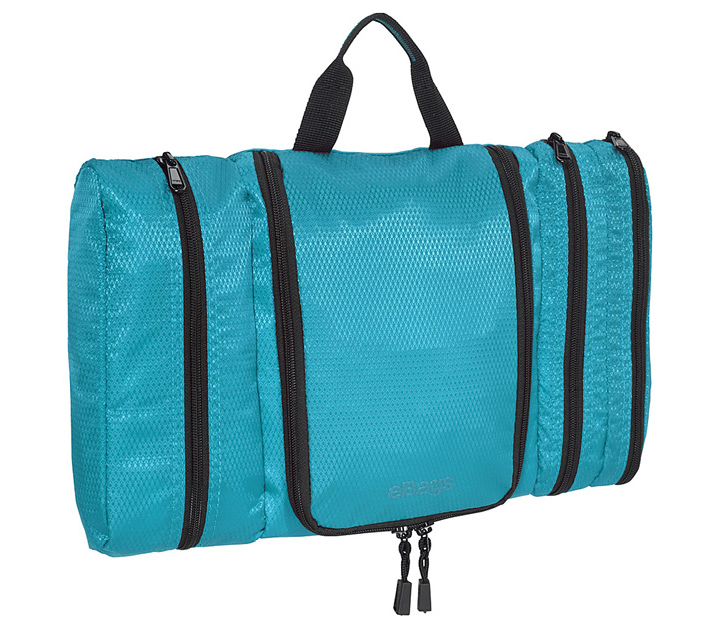 EBAGS PACK-FLAT TOILETRY KIT  This toiletry kit helps keep everything organized and fits a lot, but its very thin which makes packing it much easier than other toiletry kits.  It has 4 compartments including one that is plastic lined and it has a hook for easy hanging.