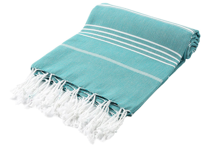 CACALA BATH TOWEL  This is an amazing towel that can double as so many other things.  It absorbs even better than terrycloth but without all the bulk and it dries very quickly.  When unfolded its pretty large and can double as a blanket, beach towel or even sarong.  Best of all it folds up to take up no more space than a tshirt!