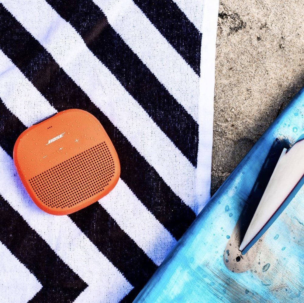 Boses' Soundlink Micro doesn't scare at a little sand or spray at the beach. Photo cred instagram: @bose