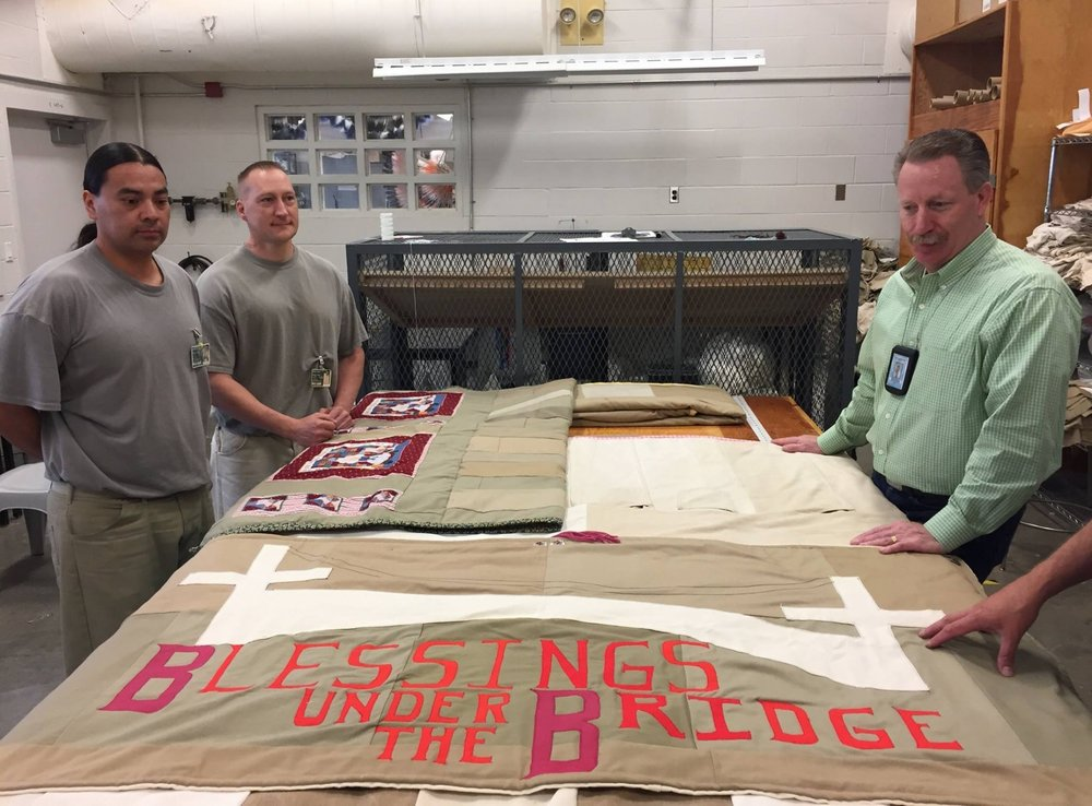 These are quilts the offenders are making from old coats and pants. The fill is from old bedding. Volunteers have donated some of their craft supplies to dress up the quilt. These are then donated to Blessings Under the Bridge. - WA State dept of corrections facebook June 2017