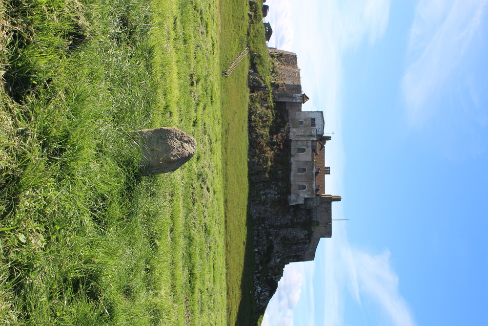 Linidisfarne Castle and the spot marker of the original monastery of the 793 raid