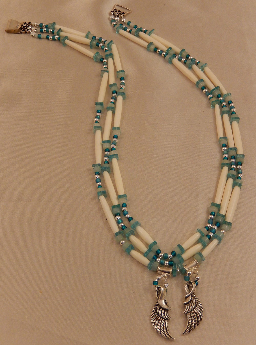 White hairpipe bone and sterling silver necklace with apatite and amazonite gemstones.