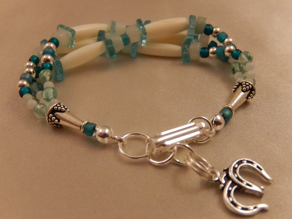 White hairpipe bone and sterling silver bracelet with apatite and amazonite gemstones.