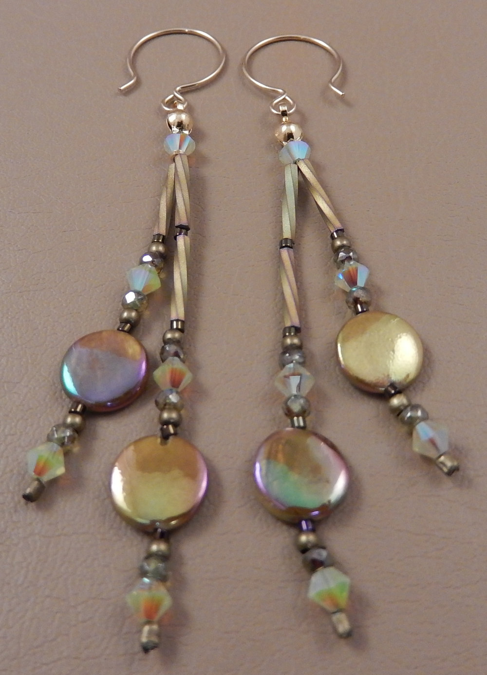 Gold mother of pearl coin bead earrings featuring swarovski chrysolite opal crystals.