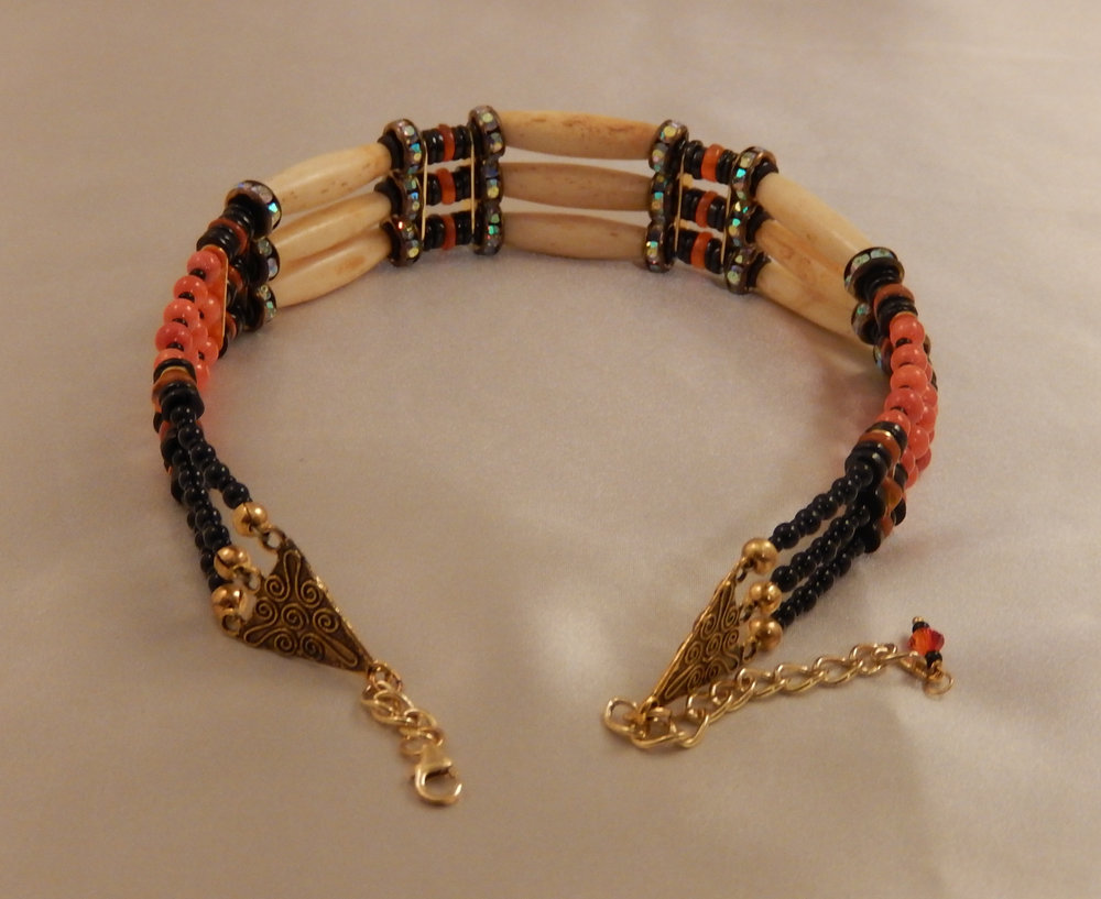Antiqued hairpipe bone choker featuring carnelian, black onyx, and black spinel gemstones, and swarovski crystal rondelle accents.