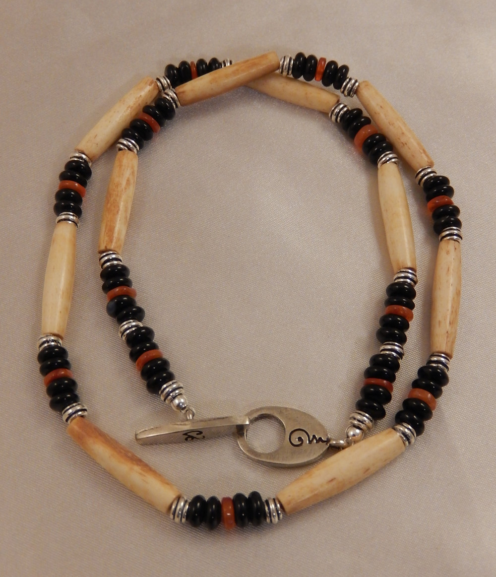 Antiqued hairpipe bone choker featuring black onyx and carnelian gemstones with sterling silver metals.