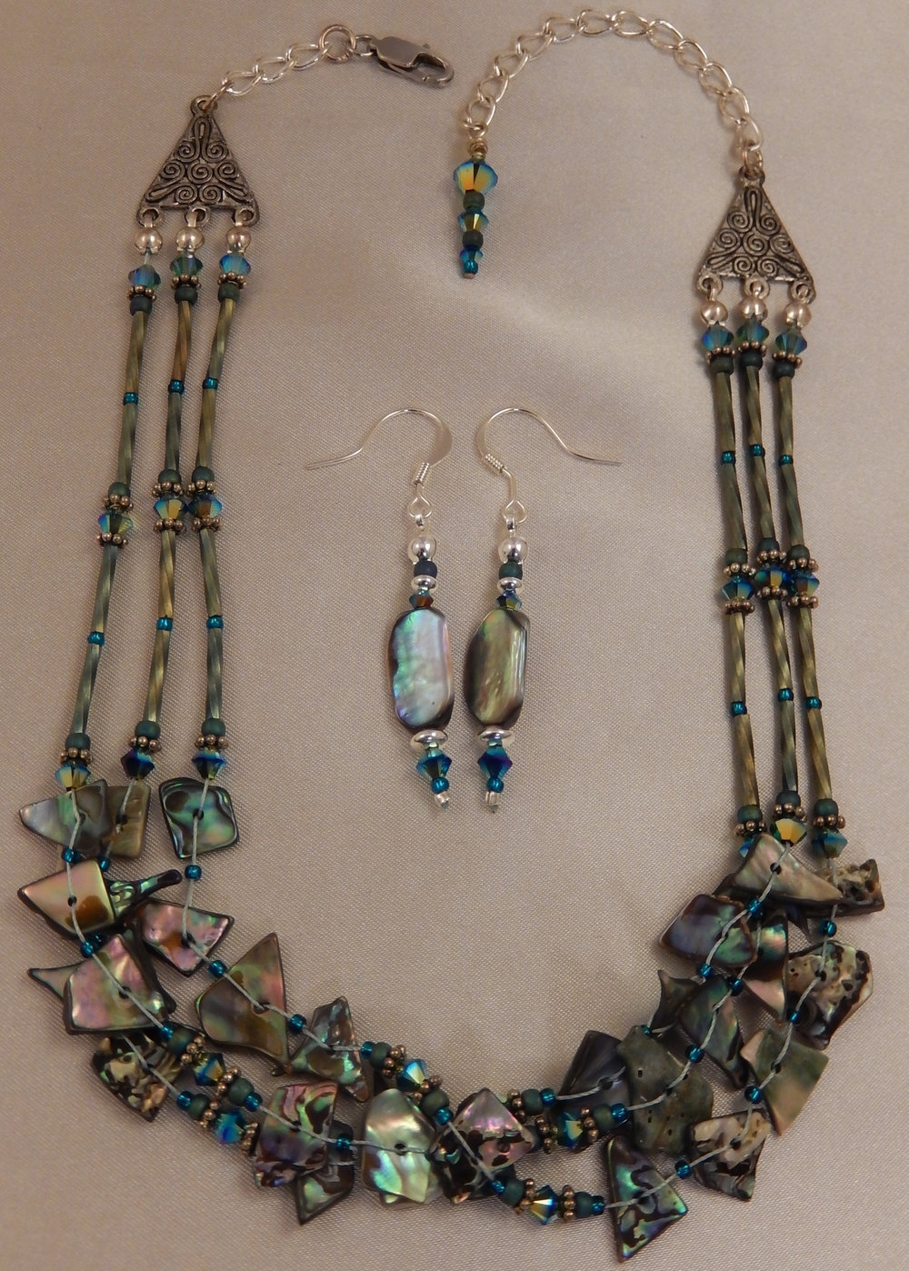 Woven abalone necklace and earring set with swarovski jet crystal accents.
