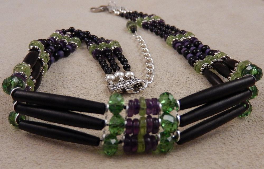 Black hairpipe bone choker with amethyst, black onyx, and peridot gemstones and swarovski crystal accents.