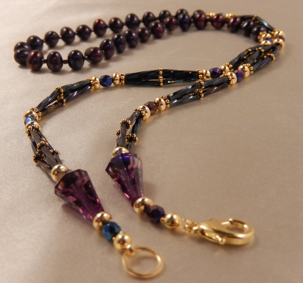 Purple freshwater pearl and purple faceted rondelle crystal necklace.