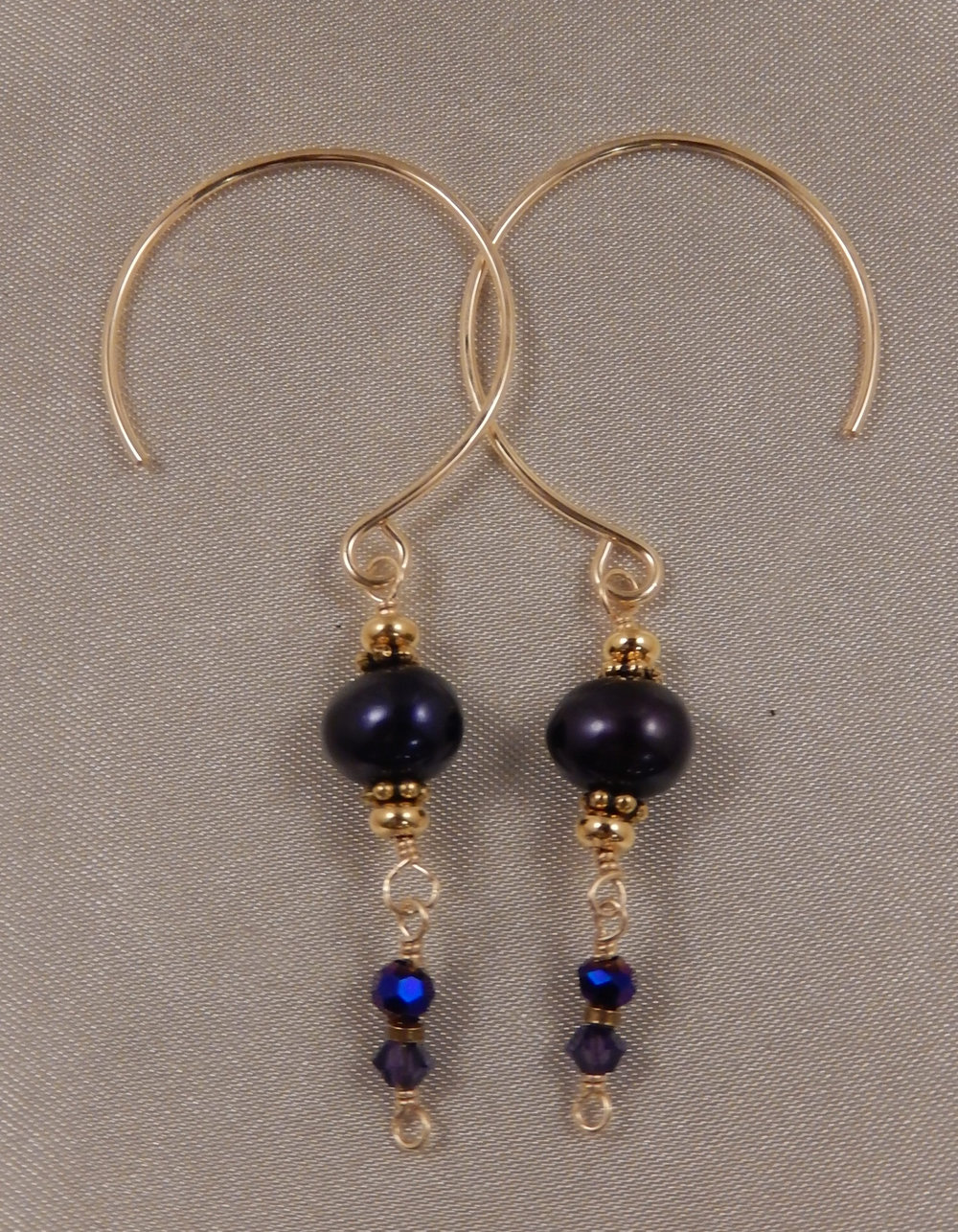 Hand wrapped purple freshwater pearl and purple faceted rondelle crystal earrings.