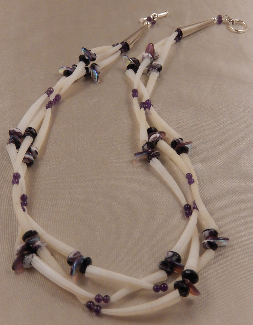 Dentalia shell necklace with amethyst gemstone rounds and czech glass rondelles in dark purple with white swirls.