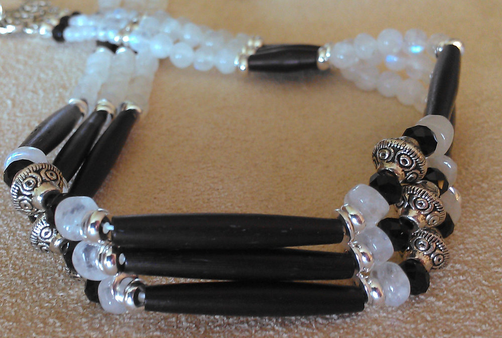 Black hairpipe bone and rainbow moonstone choker with silver plated Bali style beads and sterling silver spacers.