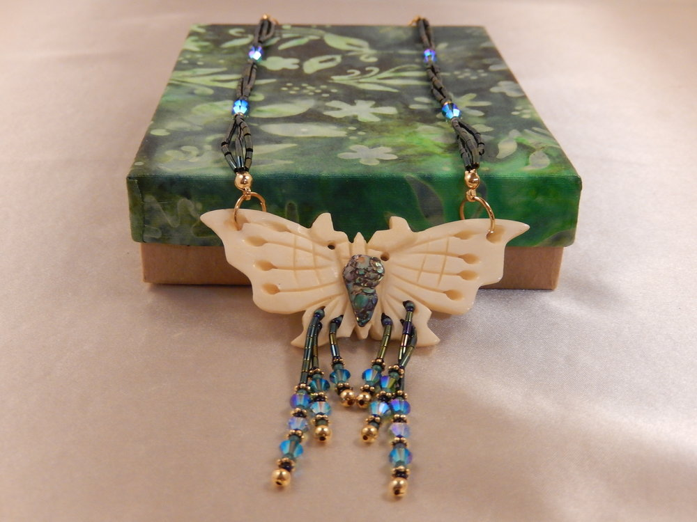 Carved bone butterfly necklace with free-form New Zealand paua shell and swarovski crystals