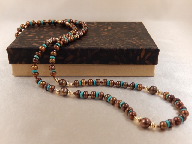 Bronze freshwater pearls and turquoise make a striking combination with a southwestern flair.