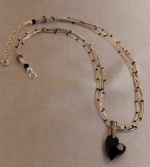 Liquid sterling silver and swarovski crystal necklace.