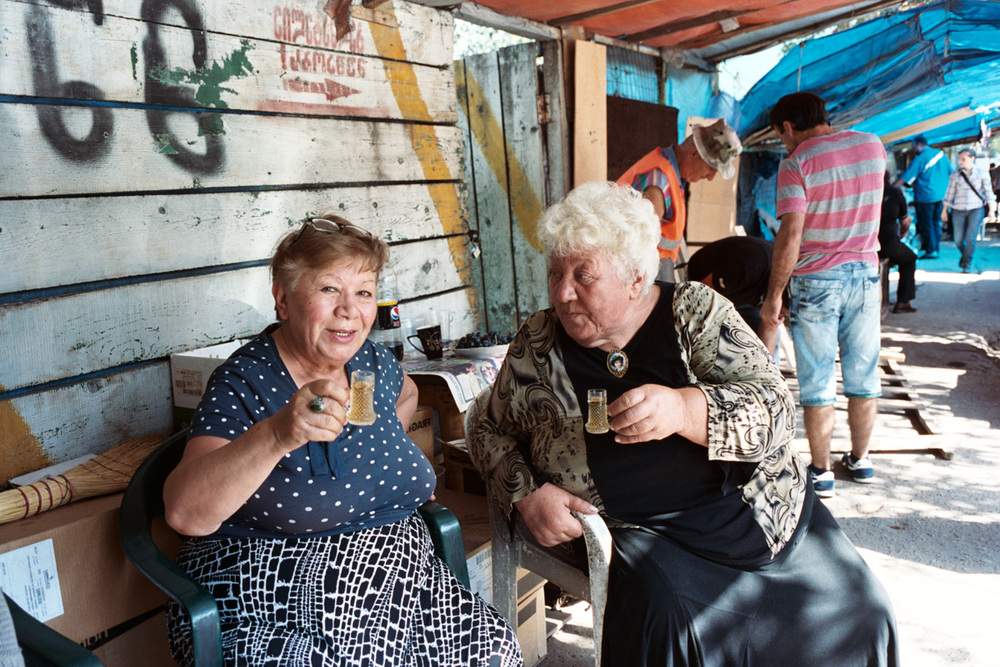 These ladies at the Tbilisi flea market invited me to drink cognac and eat cake with them.  They didn't speak a word of English, but Alex was able to converse with them in Russian.
