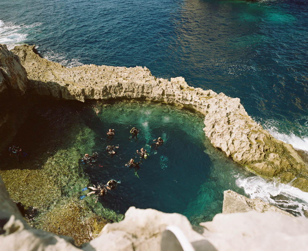 Gozo's world famous dive site, the Blue Hole.  You can either start or end your dive through this hole to the sea.