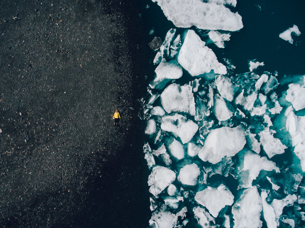 "One of my favorite ""drone selfies"" to date on the black sand at the shore of the glacier lagoon."
