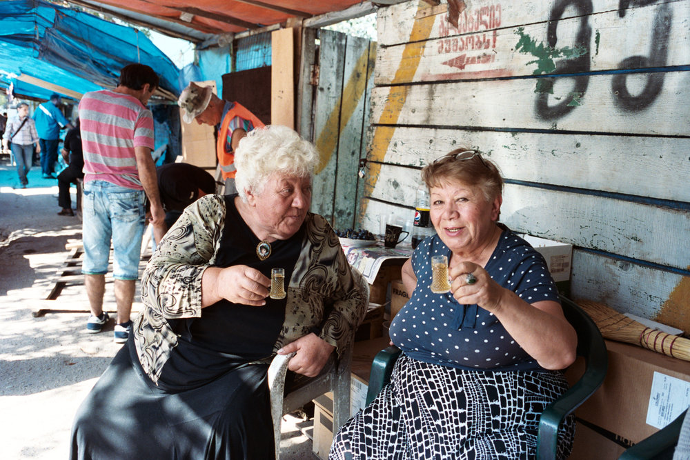 These ladies at the Tbilisi flea market invited me to drink cognac and eat cake with them (they insisted!).  They didn't speak a word of English, but Alex was able to converse with them in Russian.