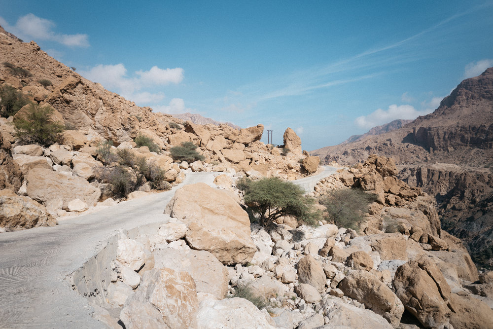 Although not the steepest stretch of the road to and from Wadi Tiwi, this photo shows you how narrow and winding the road is as it climbs the hillside, swerving between boulders.