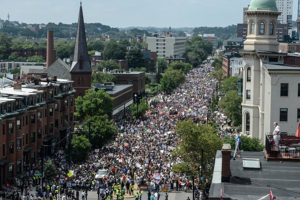 Photo of thousands of anti-white supremacist protesters marching in Boston; Stephanie Keith via Twitter/Newsweek