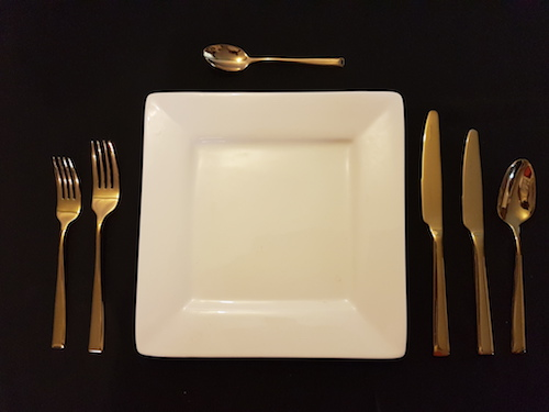 gold cutlery table setting