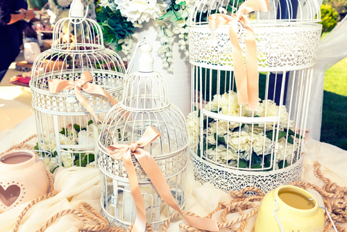 birdcages with florals as gift table centrepiece