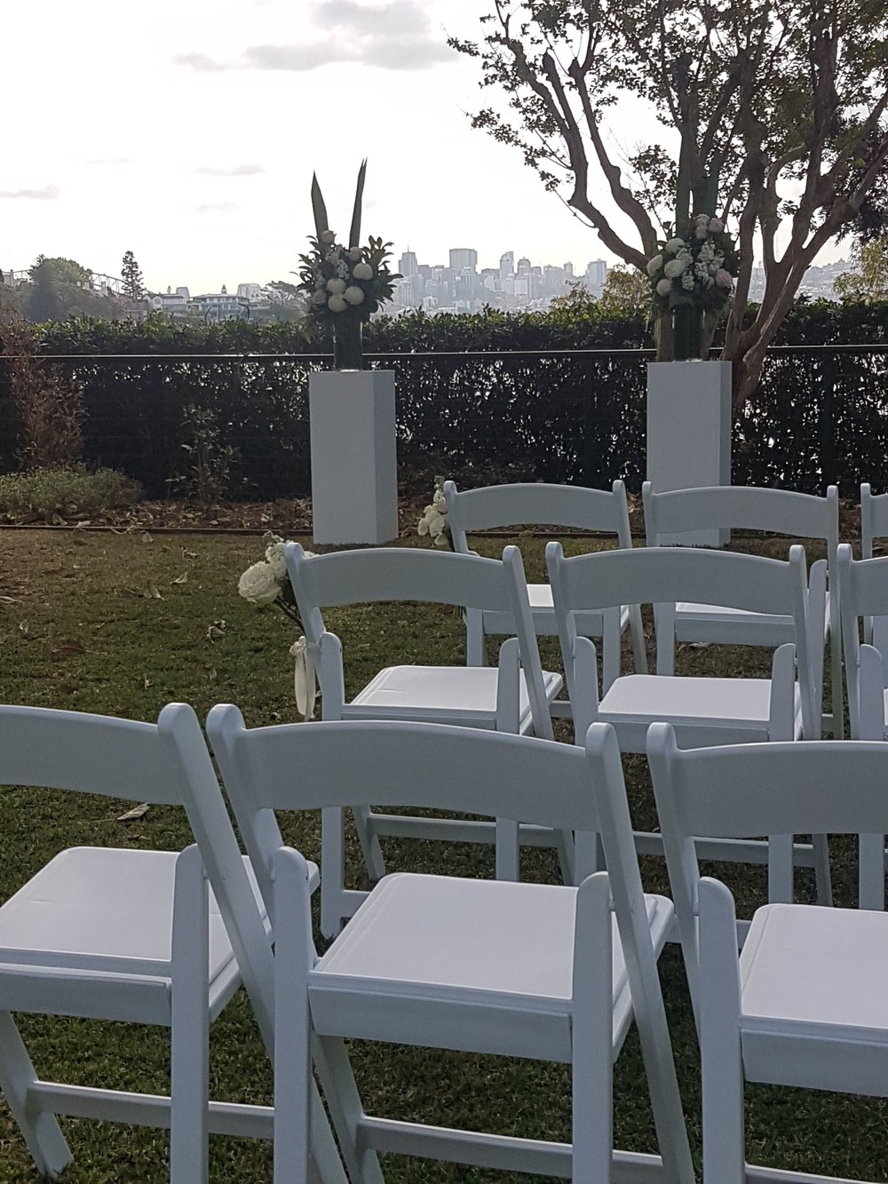 white folding ceremony chair