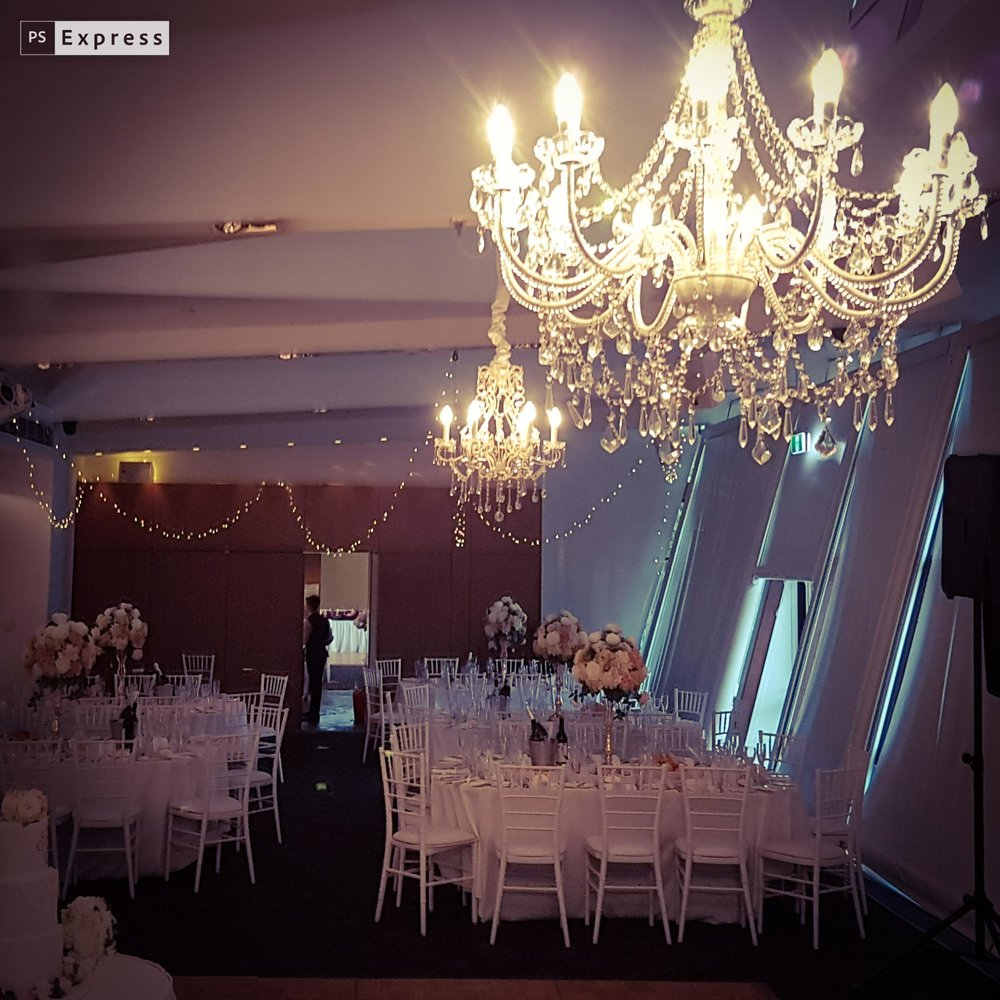 12 arm crystal chandelier and FAIRY LIGHTS in the ceiling @ L'Aqua terrace room  http://docksidegroup.com.au/venues/laqua