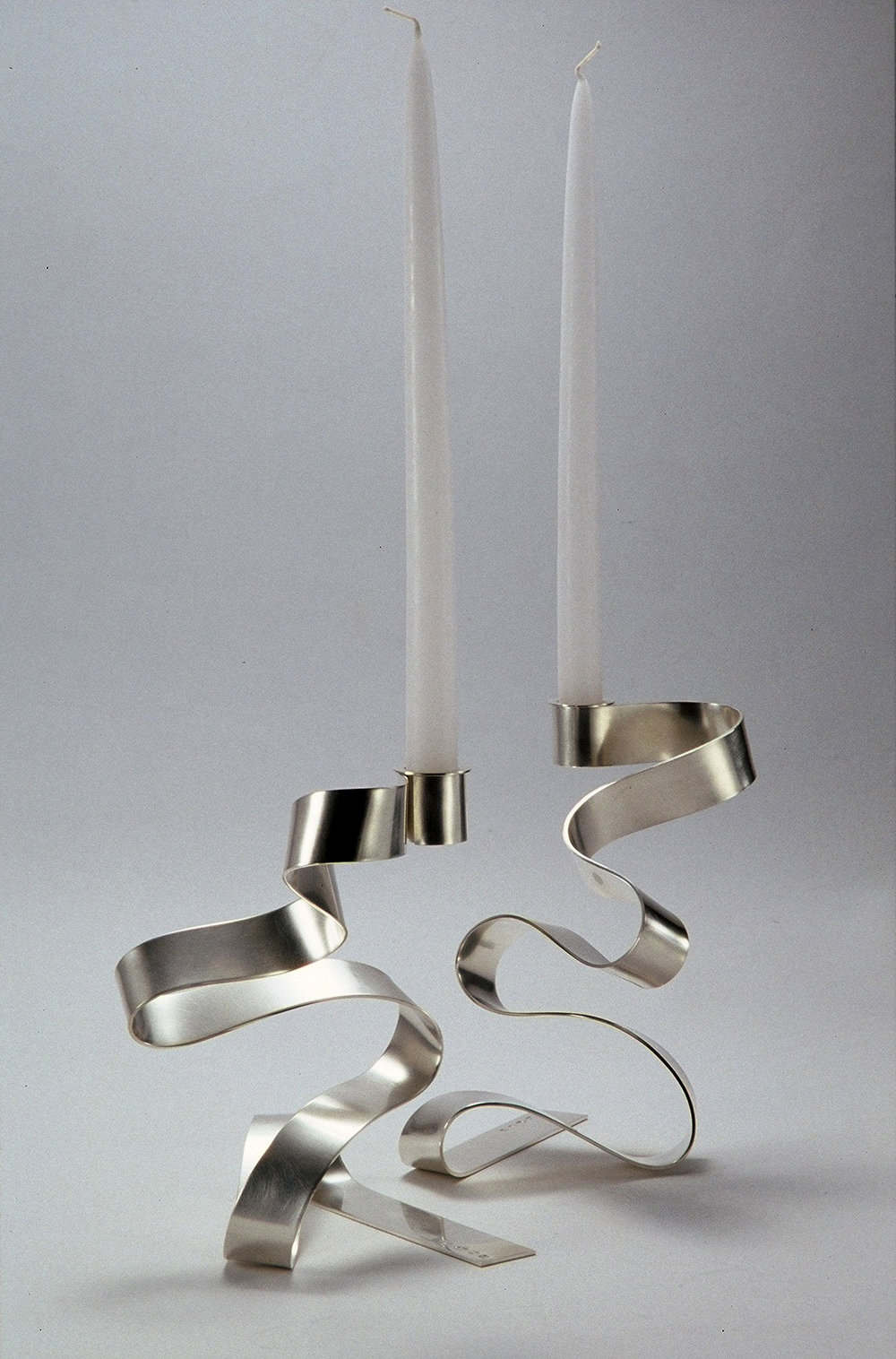 A pair of 'Ribbon Candlesticks' sterling silver
