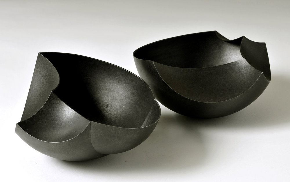 A pair of 'Introverted Bowls' in patinated copper