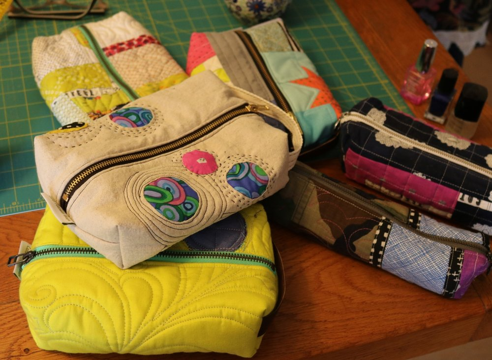 Quilted Zipper Bags  using theDomestic Sewing Machine - This fun class covers the basics of free motion quilting, zipper installation and bag making. Perfect for any quilter who has too many orphan blocks laying around, anyone wanting to explore more features of their sewing machine, or anyone who needs quick gifts to shower upon their loved ones. We will explore creating different shape and sized bags. Each student will leave with at least 2 unique zipper bags.