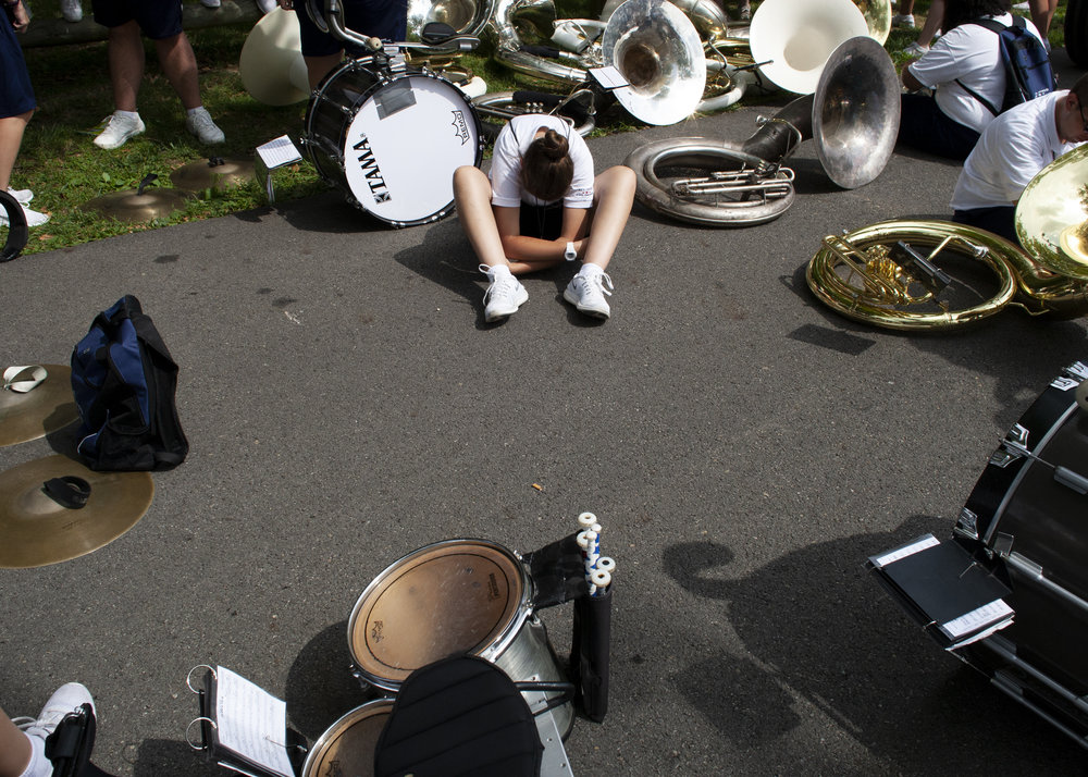 A high school band member rests in between parades at the Ohio State Fair on July 29, 2018.