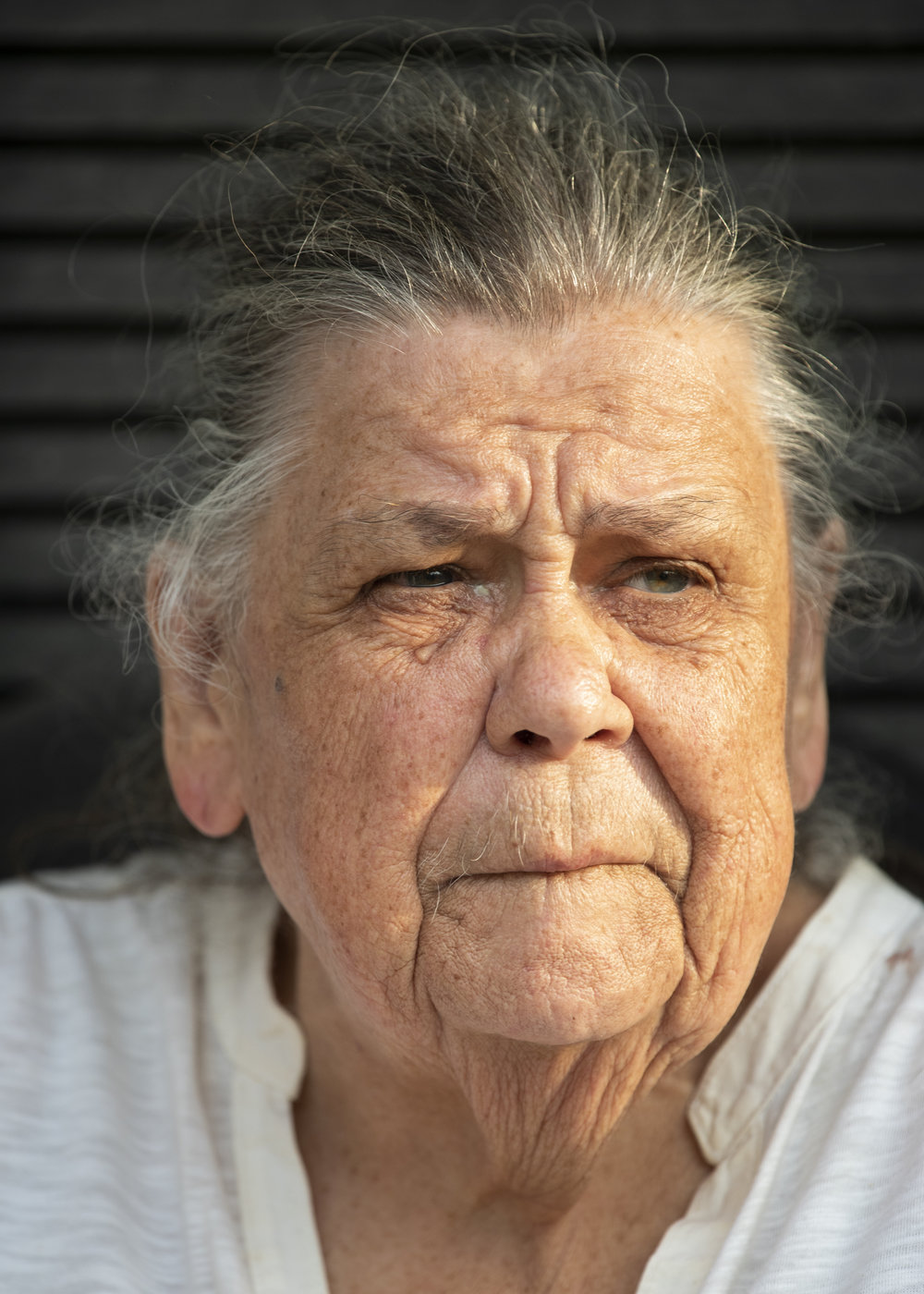 Ida Shumaker sits on her porch on North Church Street in Cynthiana, KY, on July 10, 2018.