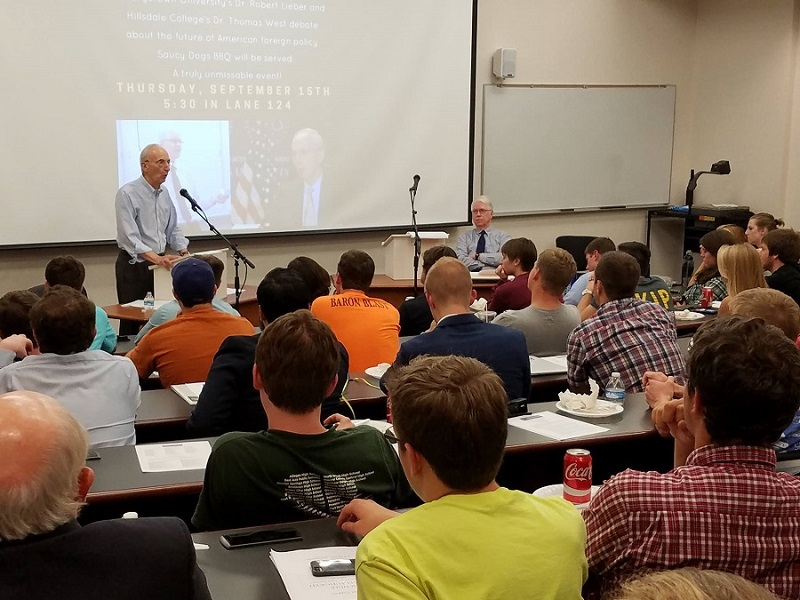 PHOTO: The debate between professors West and Lieber (Josh Paladino/Collegian)