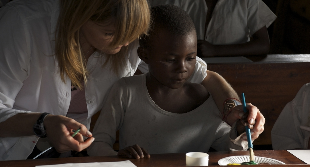 Founder Lysa Heslov with a student in Congo teaching a CMH workshop, 2009.